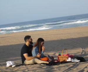 Couple enjoying picnic on the beach