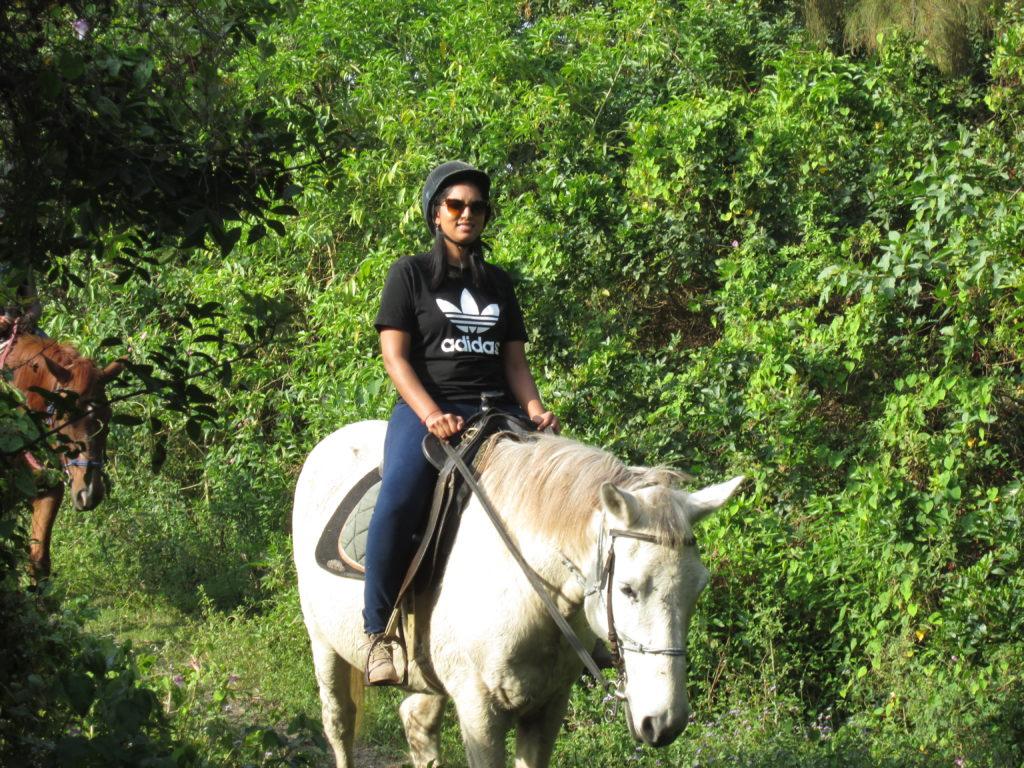 A riding student enjoys a bush trail after a few lessons